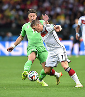 FUSSBALL WM 2014                ACHTELFINALE Deutschland - Algerien               30.06.2014 Mehdi Mostefa (li, Algerien) gegen Bastian Schweinsteiger (re, Deutschland)