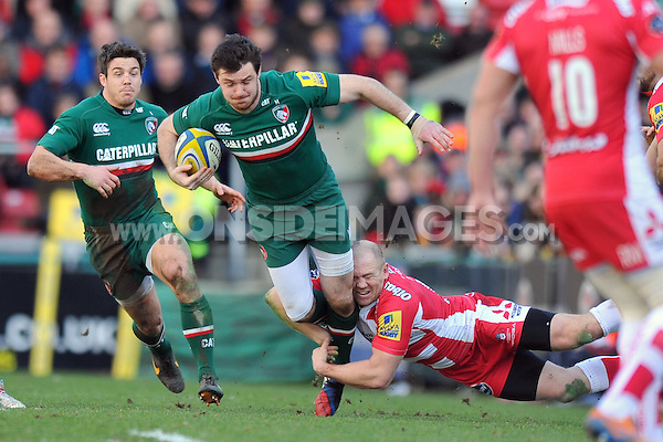 Matt Smith is tackled by Mike Tindall. Aviva Premiership match, between Leicester Tigers and Gloucester Rugby on February 16, 2014 at Welford Road in Leicester, England. Photo by: Patrick Khachfe / JMP