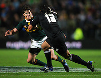 All Blacks centre Ma'a Nonu tries to beat Jaque Fourie during the Investec Tri-Nations rugby match between the NZ All Blacks and South African Springboks at Waikato Stadium, Hamilton, New Zealand on Saturday 12 September 2009. Photo: Dave Lintott / lintottphoto.co.nz