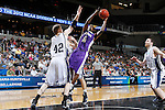 24 MAR 2012:  D.J. Rivera (5) of the University of Montevallo goes to the basket against Chris Mitchell (42) of the Western Washington University during the Division II Men's Basketball Championship held at the Bank of Kentucky Center in Highland Heights, KY. Western Washington won the national title 72-65.  Joe Robbins/NCAA Photos