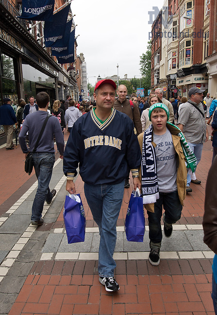 Aug. 31, 2012; Notre Dame fans walk along Grafton Street in Dublin...Photo by Matt Cashore/University of Notre Dame