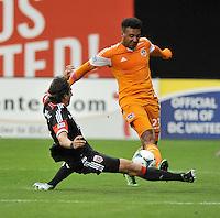 Dejan Jakovic (5) of D.C. United goes against Giles Barnes (23) of the Houston Dynamo. The Houston Dynamo defeated D.C. United 4-0, at RFK Stadium, Wednesday May 8 , 2013.