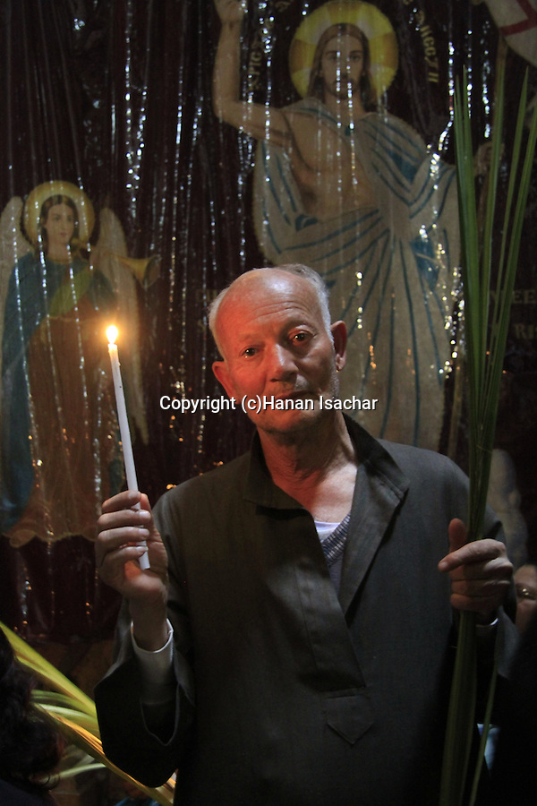 Israel, Jerusalem, Coptic Orthodox pilgrim at the Church of the Holy Sepulchre on Palm Sunday