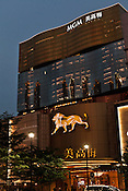 The MGM casino and the shopping centreas seen at dusk in Central Macau, China.