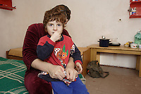 Chechen woman with the one of her daughters in URiC Wola Refugee Centre in Poland..Husband has been arrested in 2004 and never came back home. He is reported missing (dead)..She received the permit for  tolerate stay and now has to leave the Centre in 2 weeks. She has no place to go..-For security reason, the face of the adult asylum seeker have been evicted of the photography..-For security reason, the names of the adult asylum seeker have been change. .-Article 9 of the Act of 13 June 2003 on grating protection on the Polish territory (Journal of Laws, No 128, it. 1176) personal data of refugees are an object of particular protection..-Cases where publication of a picture or name of asylum seeker had dramatic consequences for this persons and is family back in Chechnya. .Please have safety of those people in mind. Thank you.