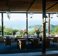 A view from one of several terraces overlooking the Caribbean and the white beach below the house