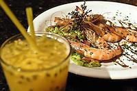 Brazilian cuisine, Camarão à Paulista ( Shrimp a Paulista mode ), served with batida de maracujá ( passion-fruit batida ) at Mangue Seco restaurant at Lapa district in Rio de Janeiro, Brazil. Batida is a brazilian drink made of cachaça, a fruit, sugar and ice.