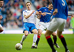 Rangers v St Johnstone....27.02.11 .Alan Maybury gets clattered by David Healy.Picture by Graeme Hart..Copyright Perthshire Picture Agency.Tel: 01738 623350  Mobile: 07990 594431