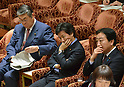 February 3, 2012, Tokyo, Japan - Japans Defense Minister Naoki Tanaka, left, goes through his reference papers during a Diet lower house Budget Committee meeting in Tokyo on Friday, February 3, 2012. Listening to an opposition lawmaker are, Prime Minister Yoshihiko Noda, right, and Finance Minister Jun Azumi...Tanaka was caught in a crossfire from the opposition camp when a senior Defense Ministry official has come under fire for encouraging his subordinates to vote in the upcoming mayoral election in Ginowan, Okinawa Prefecture, which hosts the U.S. Marine Corps' Air Station in Futennma. (Photo by Natsuki Sakai/AFLO) AYF -mis-