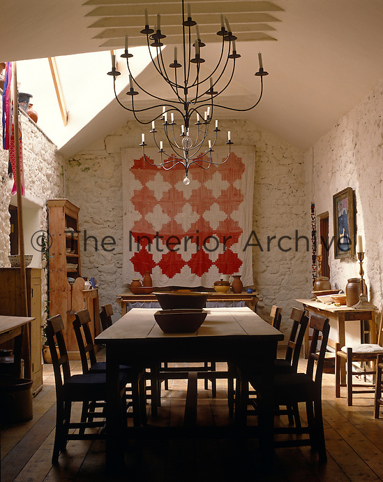 The long barn which is lit from the conservatory doubles as a studio and the dining table is made from an old door