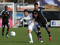 Steven Beitashour of Earthquakes fights for the ball against John Thorrington of Whitecaps during the game at Buck Shaw Stadium in Santa Clara, California on April 7th, 2012.  San Jose Earthquakes defeated Vancouver Whitecaps, 3-1.