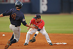Mississipp second baseman Alex Yarbrough (2) tags out UT-Martin's Cody Terry on a steal attempt during a  college baseball at Oxford-University Stadium in Oxford, Miss. on Wednesday, April 28, 2010.