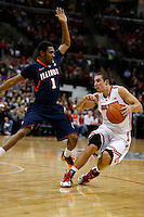 Ohio State Buckeyes guard Aaron Craft (4) drives around Illinois Fighting Illini guard Jaylon Tate (1) in the first half at Value City Arena in Columbus Jan. 23, 2013 (Dispatch photo by Eric Albrecht)