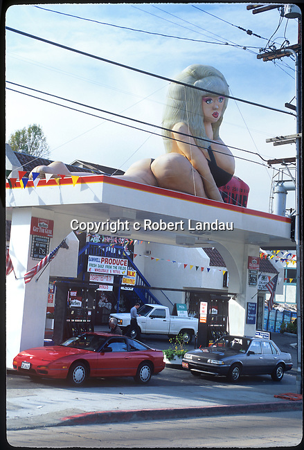 Angelyne inflatable promotion on top of gas station in Hollywood, CA date unk.
