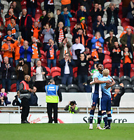 Blackpool's Jamille Matt, left, and Blackpool's Mark Cullen celebrate the win at the end of the game<br /> <br /> Photographer Chris Vaughan/CameraSport<br /> <br /> The EFL Sky Bet League Two - Doncaster Rovers v Blackpool - Keepmoat Stadium - Doncaster<br /> <br /> World Copyright &copy; 2017 CameraSport. All rights reserved. 43 Linden Ave. Countesthorpe. Leicester. England. LE8 5PG - Tel: +44 (0) 116 277 4147 - admin@camerasport.com - www.camerasport.com