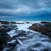 Waves crash against rocky coastline at Skagsanden beach, Flakstad, Flakstadøy, Lofoten Islands, Norway