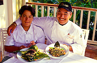 Chef Sam Choy, Jr. and his son, with food he prepared at a hotel in Kona