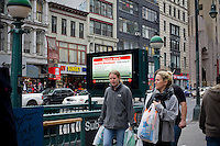 "A subway entrance information display warns of the imminent shutdown of the transit system because of Hurricane Sandy, in New York on Sunday, October 28, 2012. In advance of the arrival of Hurricane Sandy New York will shut down the subways at 7 PM on Sunday and evacuate low lying ""Zone A"" areas including Battery Park City. In addition the schools will be closed on Monday. (© Frances M. Roberts)"