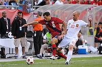 Borja Valero (10) of Spain challenges Steve Cherundolo (6) of the United States for the ball. The men's national team of Spain (ESP) defeated the United States (USA) 4-0 during a International friendly at Gillette Stadium in Foxborough, MA, on June 04, 2011.