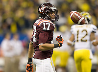 Kyle Fuller of Virginia Tech celebrates after intercepting the ball against Michigan during Sugar Bowl game at Mercedes-Benz SuperDome in New Orleans, Louisiana on January 3rd, 2012.  Michigan defeated Virginia Tech, 23-20 in first overtime.