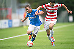 Hamilton Accies v St Johnstone...16.08.14  SPFL<br /> Chris Millar battles with Stephen Hendrie<br /> Picture by Graeme Hart.<br /> Copyright Perthshire Picture Agency<br /> Tel: 01738 623350  Mobile: 07990 594431