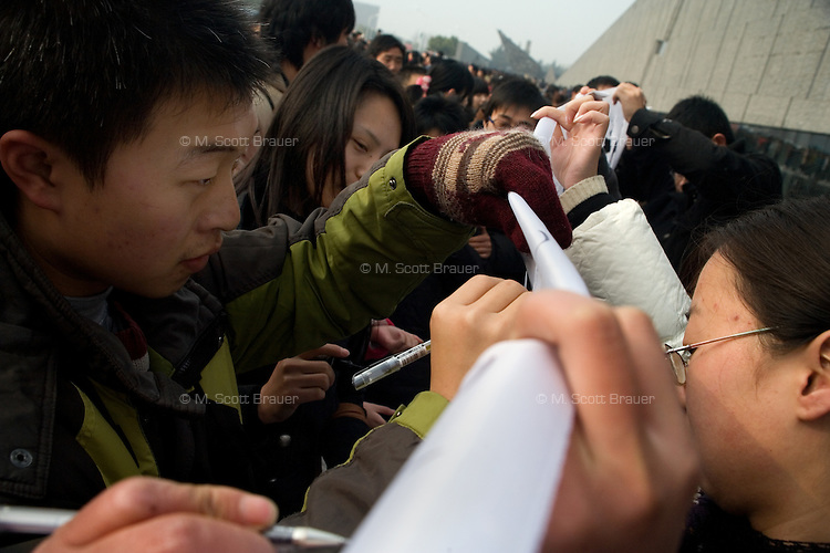 People sign a memorial banner outside the Memorial Hall of the Nanjing Massacre before being let in to see the grounds of the site.  After two years of renovations, the Memorial Hall of the Nanjing Massacre reopened on Dec. 13, 2007, the 70th anniversary of the 6-week massacre by Japanese troops that started Dec. 13, 1937 and claimed more than 300,000 lives.  The commemoration comes amid renewed controversy about the accuracy of historical accounts of the massacre.  The massacre is also known as &quot;The Rape of Nanking.&quot;