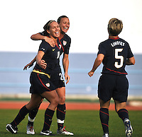US Forward Lauren Cheney #11 celebrates her game winning goal vs Iceland at a game in Vila Real Sto. Antonio, Portugal during the 2010 Algarve Cup. Cheney is being hugged by #20 Abby Wambach and is being approached by #5 Lori Lindsey.