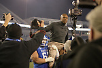 Coach Joker Phillips gets carried off the field after the second half of the UK Football game v. Samford at Commonwealth Stadium in Lexington, Ky., on Saturday, November 17, 2012. Photo by Genevieve Adams | Staff