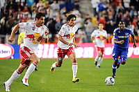 Mehdi Ballouchy (10) of the New York Red Bulls brings the ball up field moments before feeding Dane Richards (19) (not pictured) for a goal during a Major League Soccer (MLS) match against the Kansas City Wizards at Red Bull Arena in Harrison, NJ, on October 02, 2010.