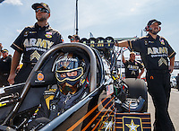Sep 5, 2016; Clermont, IN, USA; NHRA top fuel driver Tony Schumacher sits in his car alongside crew members during the US Nationals at Lucas Oil Raceway. Mandatory Credit: Mark J. Rebilas-USA TODAY Sports
