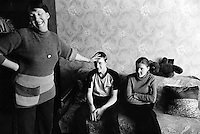 Belarus. Province of Gomel. Bolchevik. Family Takhmanova, Olga the mother 45 years old, Serguei 15 and Svetlana 13 years, at home in their living room. The family suffers physical health problems due to the Chernobyl disaster. Both children already went twice to sanatoriums in western Europe.The village of Bolchevik was heavily affected by the fallout of the catastrophe which took place on april 1986 at 1.23 am in the Chernobyl atomic power station. The accident in the nuclear power plant has environmentals effects which affect territories and health of the people. The village of Bolchevik is still contamined by radioactive materials, like caesium 137. © 2006 Didier Ruef