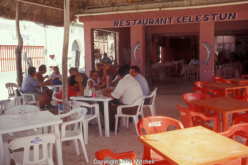 People eating on a restaurant in the village of Celestun, Yucatan, Mexico