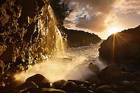 The sun bursts through in spectacular fashion near Queens Bath on Kauai's north shore.