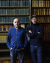 "Bristol, UK. 28.11.2015. Artists, John Wood and Paul Harrison, present ""Erdkunde: The Study of the Earth"", a new video work inspired by Bristol Museum's geology collections. The work forms part of the New Expressions 3 series of new collaborations. Picture shows: Artists, John Wood and Paul Harrison, in the library at Bristol Museum. Photograph © Jane Hobson."