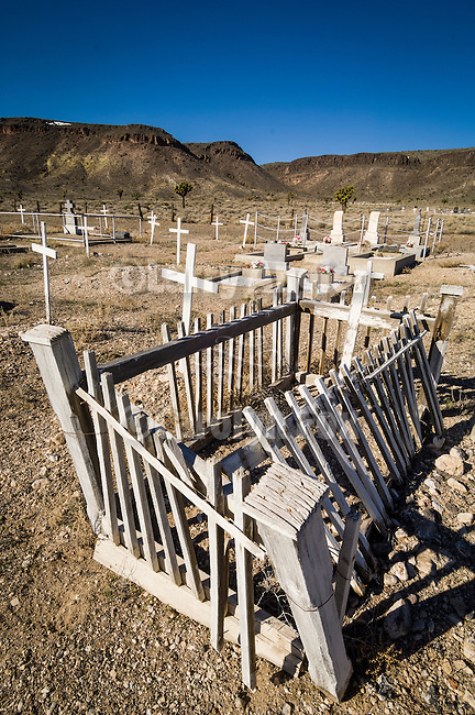 A grave with weathered and falling in fence at the historic early 1900s cemetery in Goldfield, Nev.