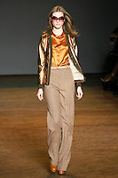 Jac walks runway in a partridge limelight metallic leather jacket, cognac multi disco satin blouse, dachsund multi poxy herringbone pants, and luggage lace up oxfords, from the Marc by Marc Jacobs Fall/Winter 2011 collection, during New York Fashion Week, Fall 2011.