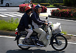 Japanese couple on a Honda motorcycle, Tokyo - with their dog. Derek, a colleague of mine, spotted them from the window of the bus, so I had to tear my camera out of bag, and managed to get this scene...