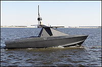 BNPS.co.uk (01202 558833).Pic: AlSeer/BNPS..***Please Use Full Byline***..Oscar - 50kts, 600 mile range...The Drones have now moved onto the water - Radar proof unmanned aquatic 'stealth' boats...If you see one of these floating menacingly towards you, the advice is to get far away from it as quickly as possible...This daunting 35ft vessel belongs to the world's first fleet of unmanned 'robo-boats', designed to thwart pirates and take on dangerous covert missions without endangering the lives of crew...Looking like a cross between a miniature Navy warship and a stealth bomber, they are the waterborne equivalent of the unmanned drone planes used by the UK and US militaries in the fight against terror...The Eclipse unmanned surveillance vessels can operate 24 hours a day, travel at 60mph and can be kitted out with enough weaponry to blow adversaries out of the.water...The cutting edge boats boast state-of-the-art technology that allows it to undertake search and rescue missions or patrol dangerous waters without requiring crew...They have a range of up to 600 miles and can loiter at low speeds for 10 days without refuelling...Powered by two 500 horsepower water jets made by Rolls Royse, the Eclipse range also boast £650,000 giroscopic HD cameras which take pictures of their surroundings, analysing them for potential threats and and relaying.information back to a manned control station.