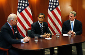 Chicago, IL - December 9, 2008 -- United States President-elect Barack Obama (C) sits with Vice President-elect Joe Biden (L) and former Vice President Al Gore after a private meeting at Obama's transition office on December 9, 2008 in Chicago, Illinois. An Obama spokesman said the three men discussed energy and climate change and how policies in those areas could help the economy.  .Credit: Brian Kersey - Pool via CNP