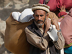 Following an October 8, 2005, earthquake, a survivor in the devastated town of Balakot.