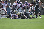 Ole Miss' Nickolas Brassell(2) recovers a fumble against Vanderbilt fullback Marc Panu (45) in Nashville, Tenn. on Saturday, September 17, 2011. Vanderbilt won 30-7..