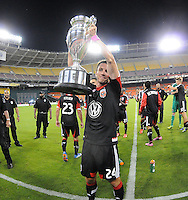 Lewis Neil (24) of D.C. United presenting the U.S. Open Cup Trophy to the fans at  the end of the game.  The Chicago Fire defeated D.C. Untied 3-0, at RFK Stadium, Friday October 4 , 2013.