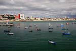 Europe, Portugal, Cascais. Fishing boats anchored offshore at Cascais on the Estoril coast.