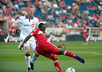 Chicago forward Patrick Nyarko (14) cuts back with the ball as Toronto defender Richard Eckersley (27) approaches.  The Chicago Fire defeated Toronto FC 2-0 at Toyota Park in Bridgeview, IL on August 21, 2011.
