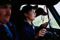 In a dirty, thankless job one of the few perks for farm kids are early responsibilities like driving the family pickup truck before they are old enough to qualify for a driver's license. This photo is taken five years after the first time eleven-year-old Jim Bansen took the farm truck onto a paved road under the watchful eye of his father, Pete.