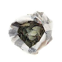 A bag of dried leaves, from a variety of potato plant, used to season bland food particularly the local staple of boiled maize porridge. The leaves are found at most local markets and are a speciality of the region. This bag costs about 50 CFA (less than GBP 0.01).&nbsp;<br /> The extreme north of Cameroon is suffering a food shortage exacerbated by climate change and conflict with Boko Haram. Fighting has spread across the borders from Nigeria into the countries of the Lake Chad region creating a refugee and famine crisis. Once an intrepid tourist destination boasting Waza national park, the extreme north of Cameroon now hosts people fleeing violence housed in unnamed refugee camps where they are lucky if they manage to get a single meal each day.<br /> &nbsp;