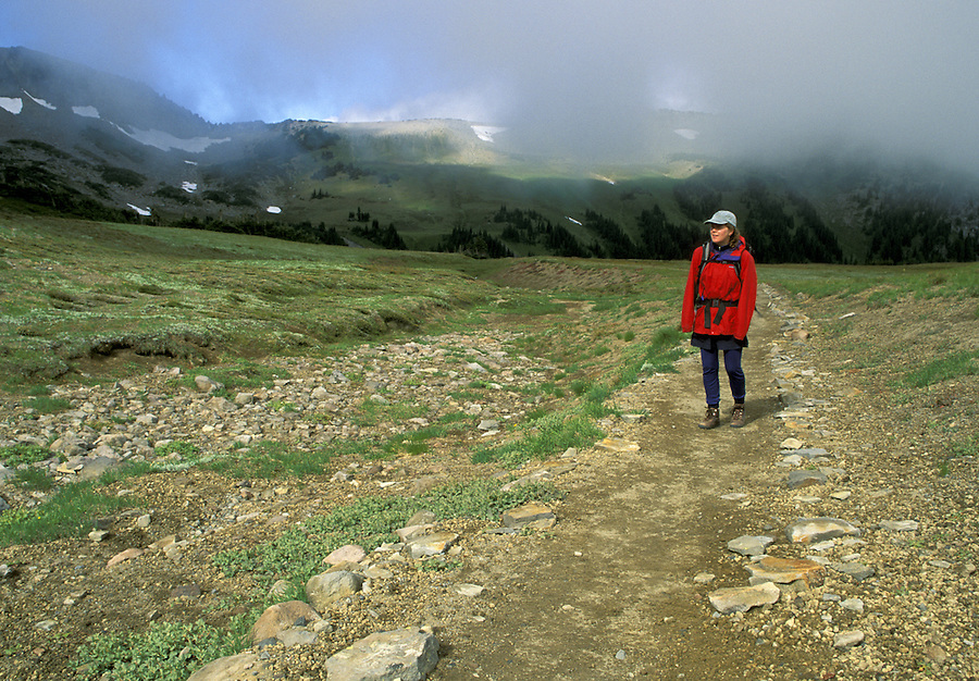 Woman hiking on trail, Mount Rainier National Park, Washington
