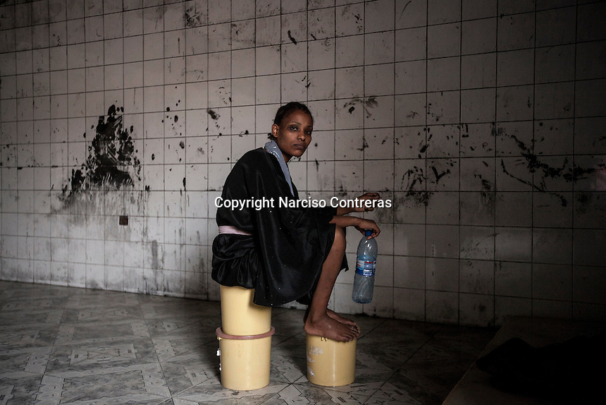A mentally ill migrant in one of the Surman detention centres on the west coast of Libya.