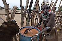 Stirring with root that makes the water drop all of its silt.  I've never seen anything like it.   Bull jumping in the Karo tribe only happens once in a generation.  This time it is happening in Duss -- so everyone is very busy with the preparations.  There will be about 14 bull jumpers in this generations group.  Lale's group was the group of the elephant. There are mothers of the bull jumpers with ostrich feather head dresses.  The mother in these photographs is interesting though.  Her name is Muko Balguda and this is her first boy to go thru the manhood ceremony.  She had 12 children that she killed before she was married.  There was war with the Nyangatom and everyone was too busy to schedule a bull jumping so she lived with her boyfriend and had 12 babies before he was able to go thru with the bull jumping and marry her.  Babies out of wedlock are killed by putting soil in their mouths and leaving them in the bush... this is called Mingi killing by the Karo and one reason why their numbers are not as much as other tribes.  Maku had three children within a marriage and one died of natural causes.  The bull jumper (naked guy) in these photos is her first son to do this..Contacts:..Lale Biwa.lalebiwa@yahoo.com