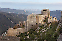 "View of Lower Castle, Peyrepertuse Castle or Chateau Pierre Pertuse, Cathar Castle, Duilhac-sous-Peyrepertuse, Corbieres, Aude, France. This castle consists of a Lower Castle built by the Kings of Aragon in the 11th century and a High Castle built by Louis IX in the 13th century, joined by a huge staircase. Its name means pierced rock in Occitan and it has been associated with the Counts of Narbonne and Barcelona. It is one of the ""Five Sons of Carcassonne"" or ""cinq fils de Carcassonne"" and is a listed monument historique. Picture by Manuel Cohen"